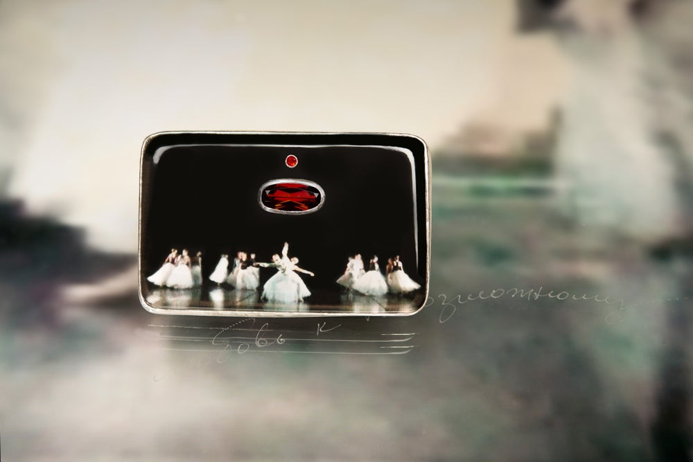Image of sterling silver brooch with sapphire, garnet and ballet photography under plexiglass