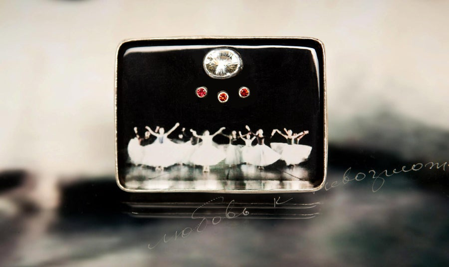 Image of sterling silver brooch with topaz, sapphires and ballet photography under plexiglass