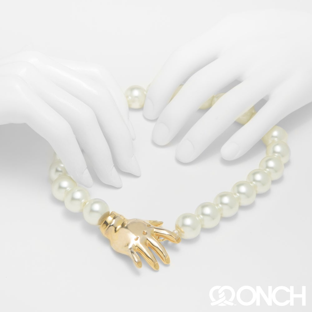 Image of Pearl Clutching