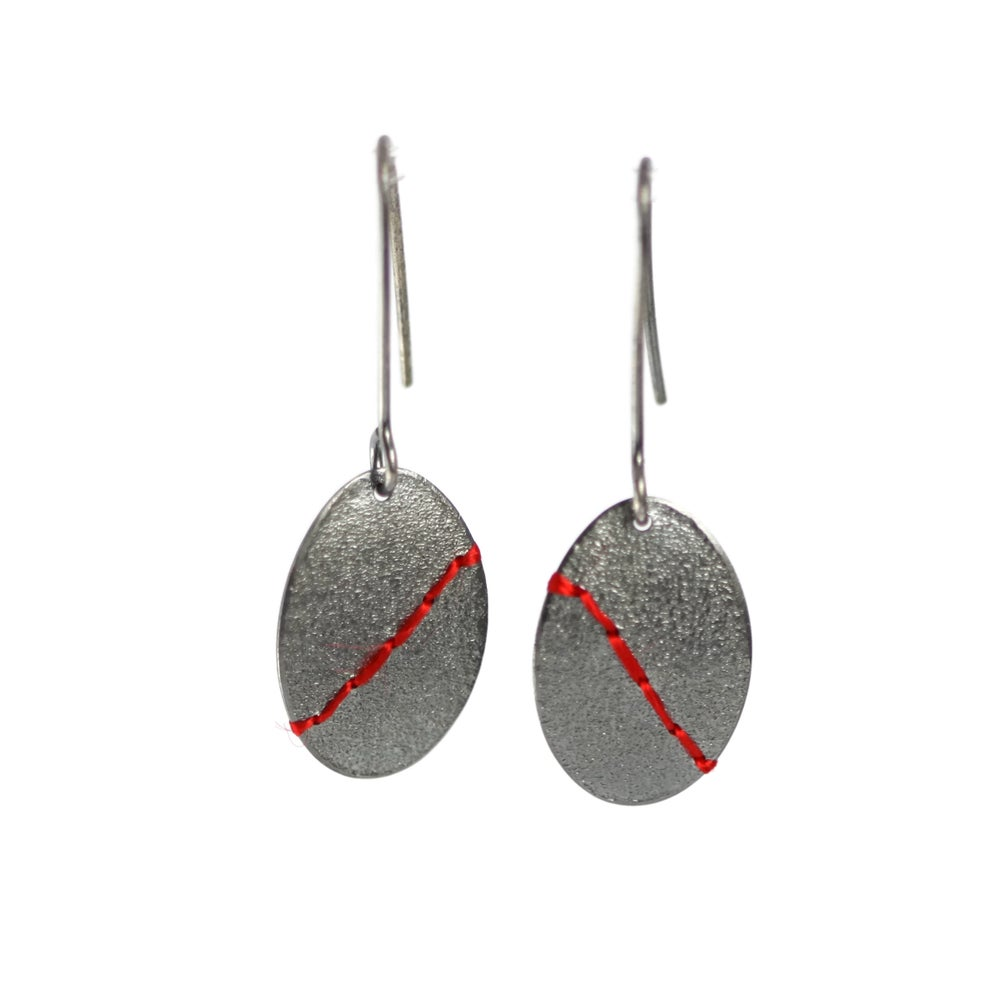 Image of Sewn Up large oval earrings