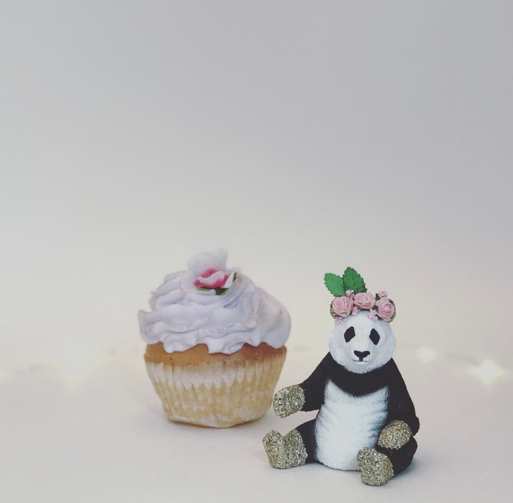 Image of PANDA with flower crown