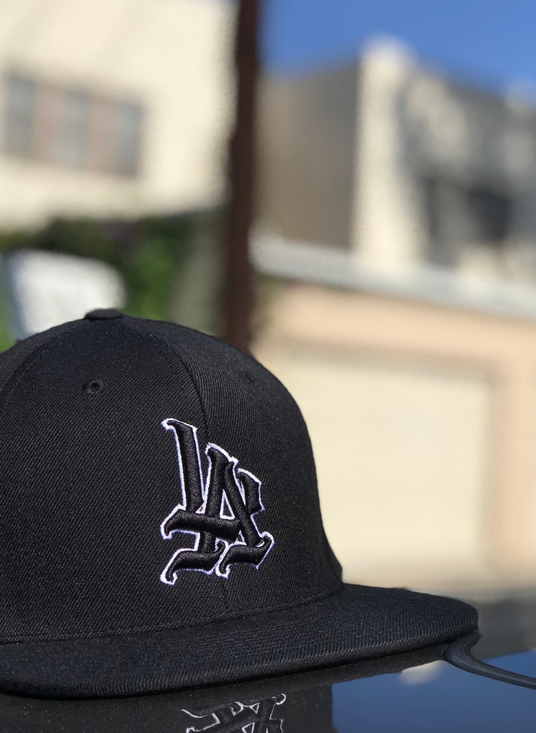Image of Black Stitched White Outline Snapback