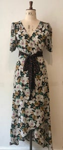 Image of Waterfall hem print and polka dot wrap dress