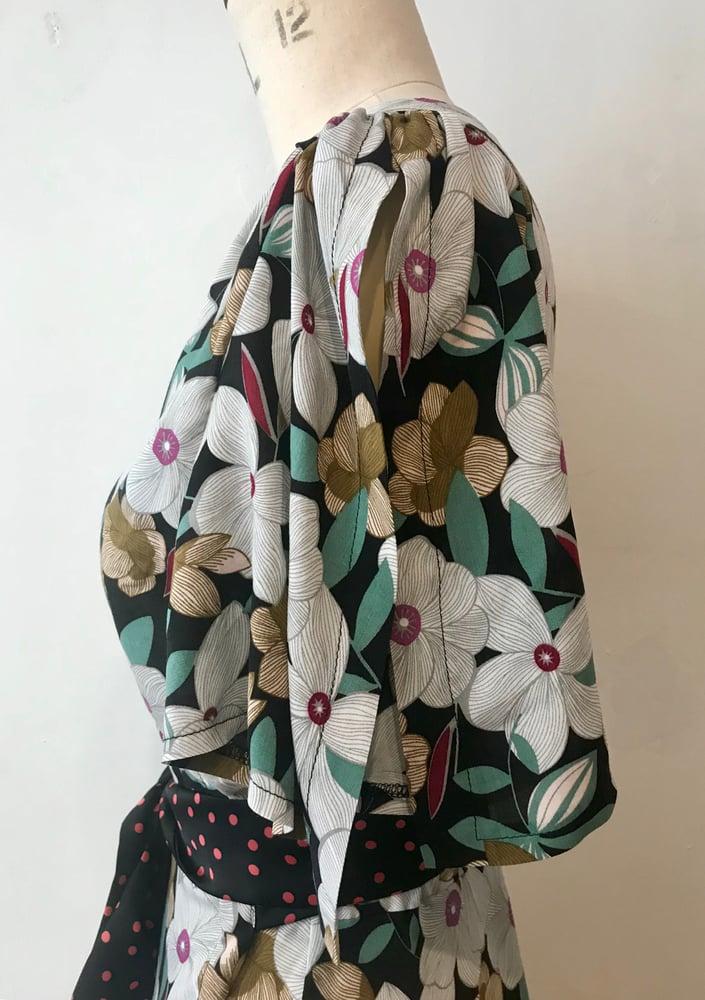 Image of Waterfall hem print and polka dot wrap dress