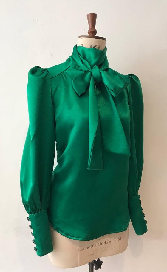 Image of Deep cuff satin tie neck blouse