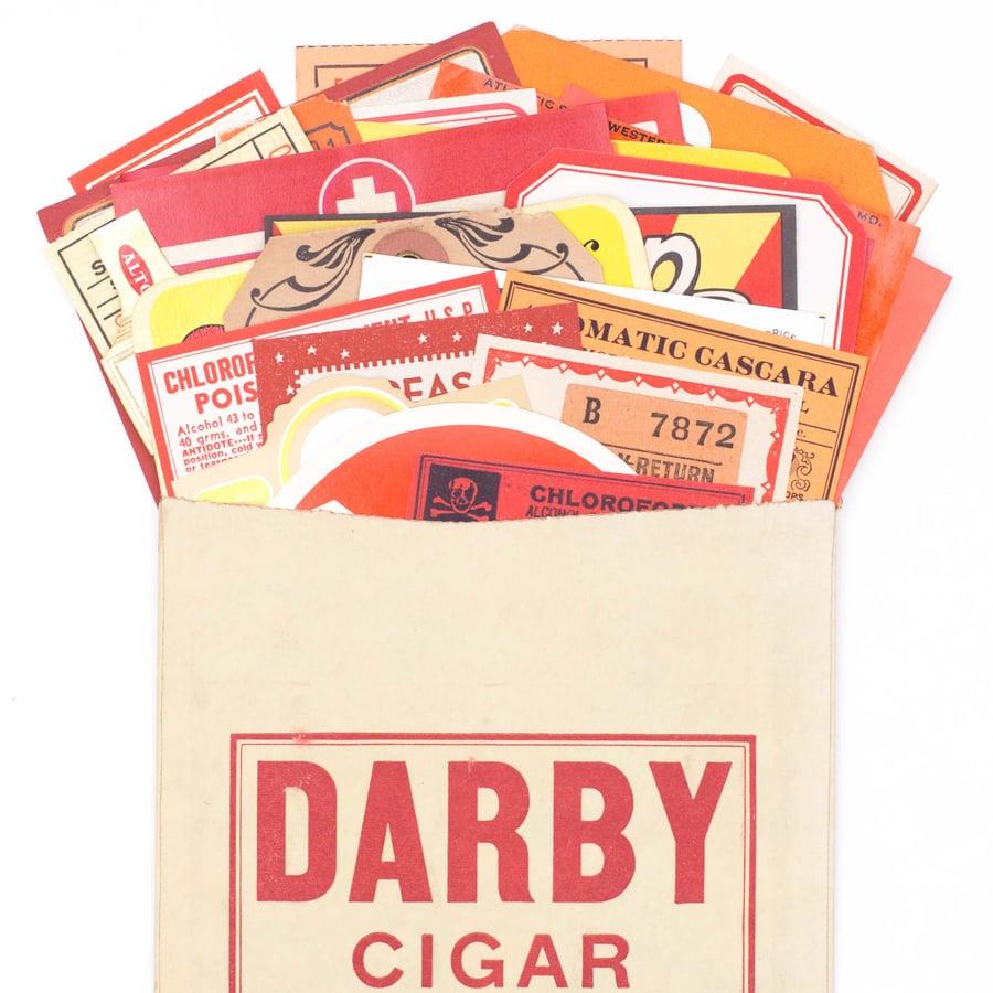 Image of Red, Orange, & Yellow Ephemera Collection in Cigar Bag
