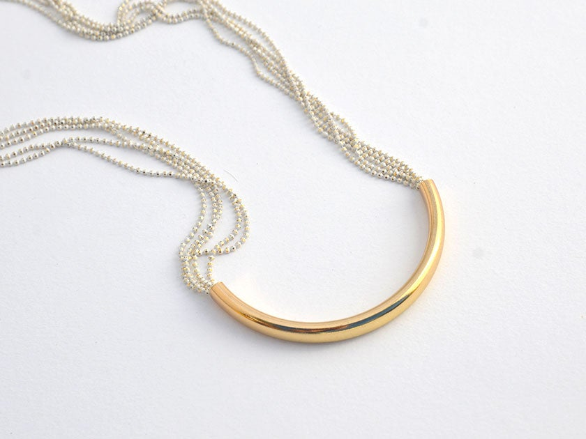 Image of gold bar white chain statement