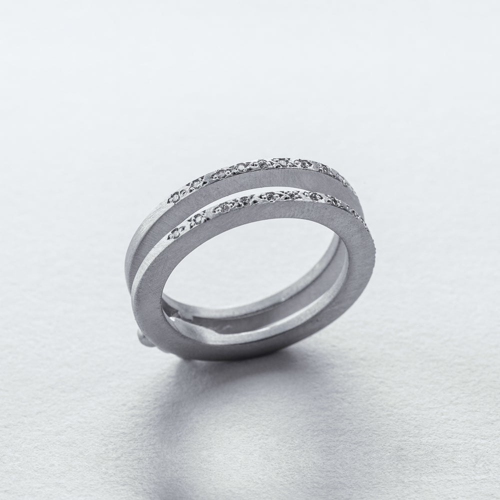 Image of INFINITY FOLDING RING W/ OUTER EDGE WHITE DIAMONDS — PLATINUM