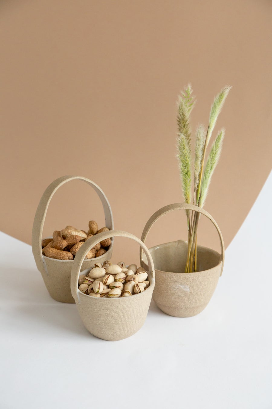 Image of Small Round Tan Ceramic Baskets