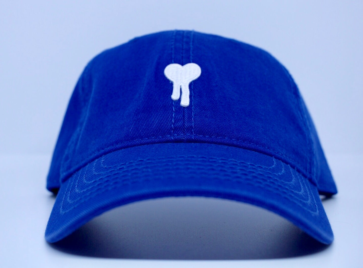 a5b5d9d26 ROYAL HEARTS.. Blue soft twill dad hat with White drip heart, strap back