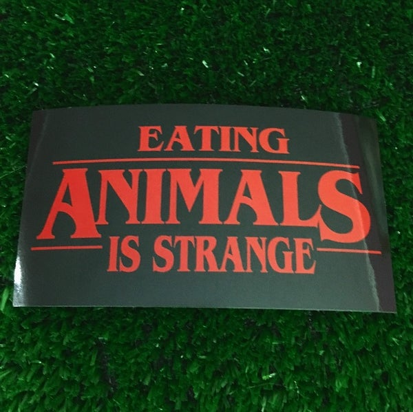 Image of Eating animals is strange vinyl sticker