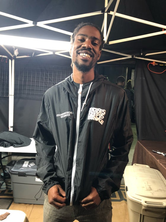 Image of Excuses Windbreaker