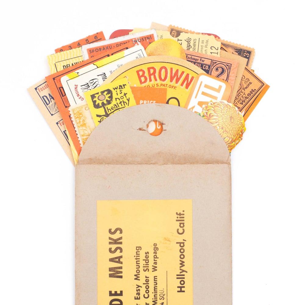 Image of Orange & Yellow Ephemera in Slide Envelope