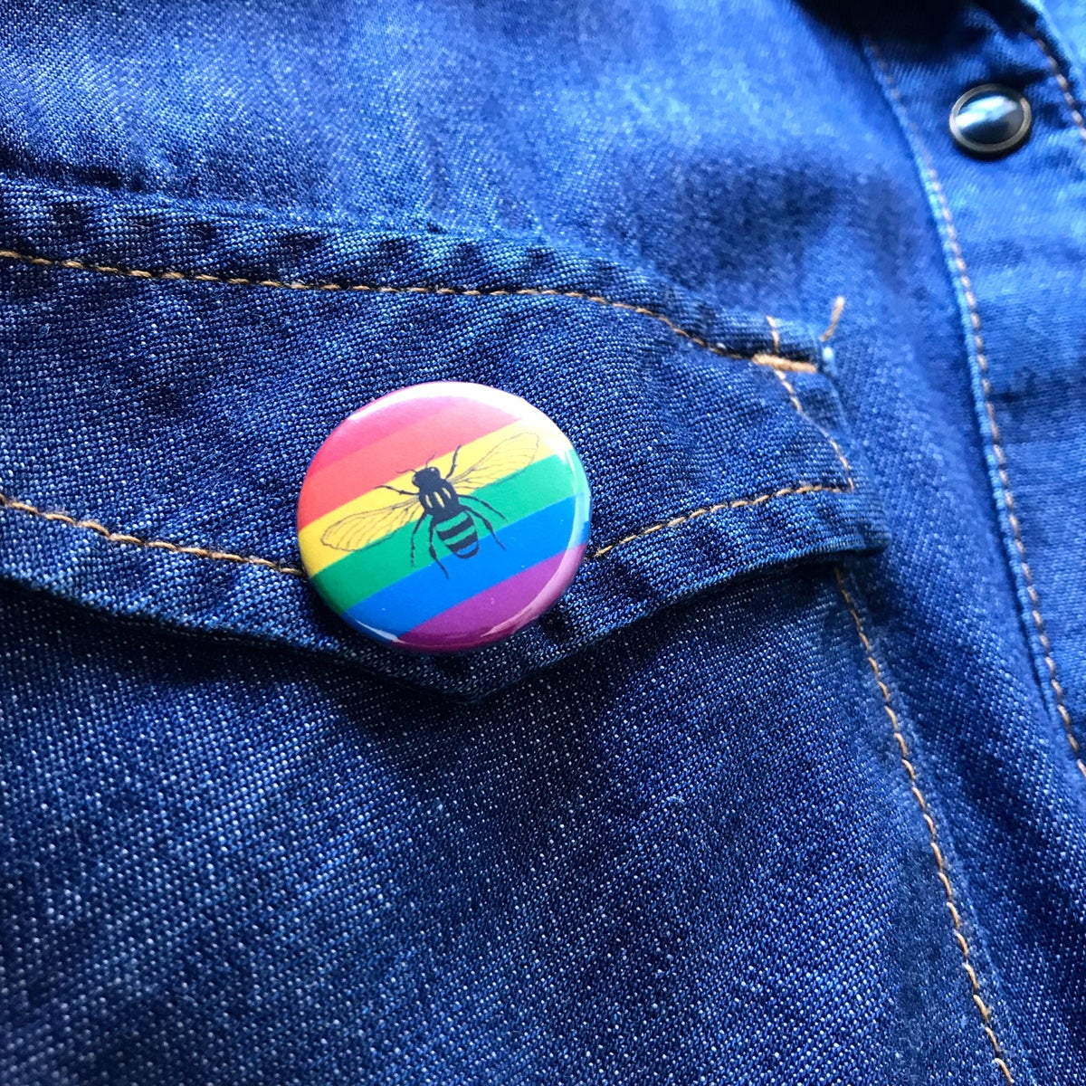 Image of Rainbow Pride Manchester Bee button badge