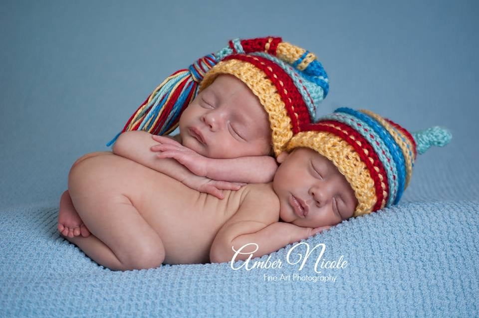 Image of Aqua, Red, Yellow, Blue Tassel Hat