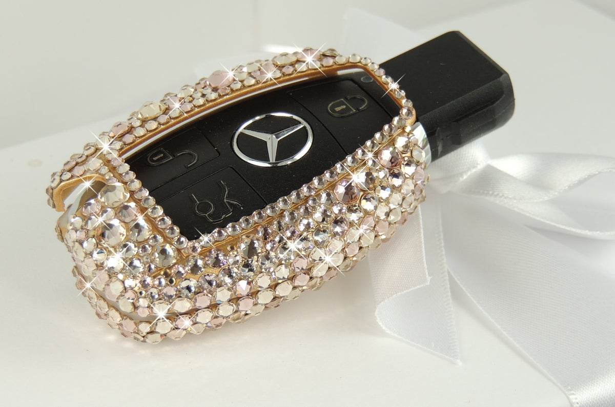 Image of Mercedes Key Case in Rose Gold, Midnight Black, Gold and Silver/White.