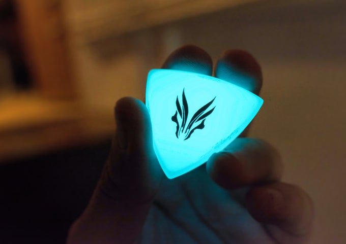 Image of The original 'Aqua Blue HUFGLOW' plectrums!