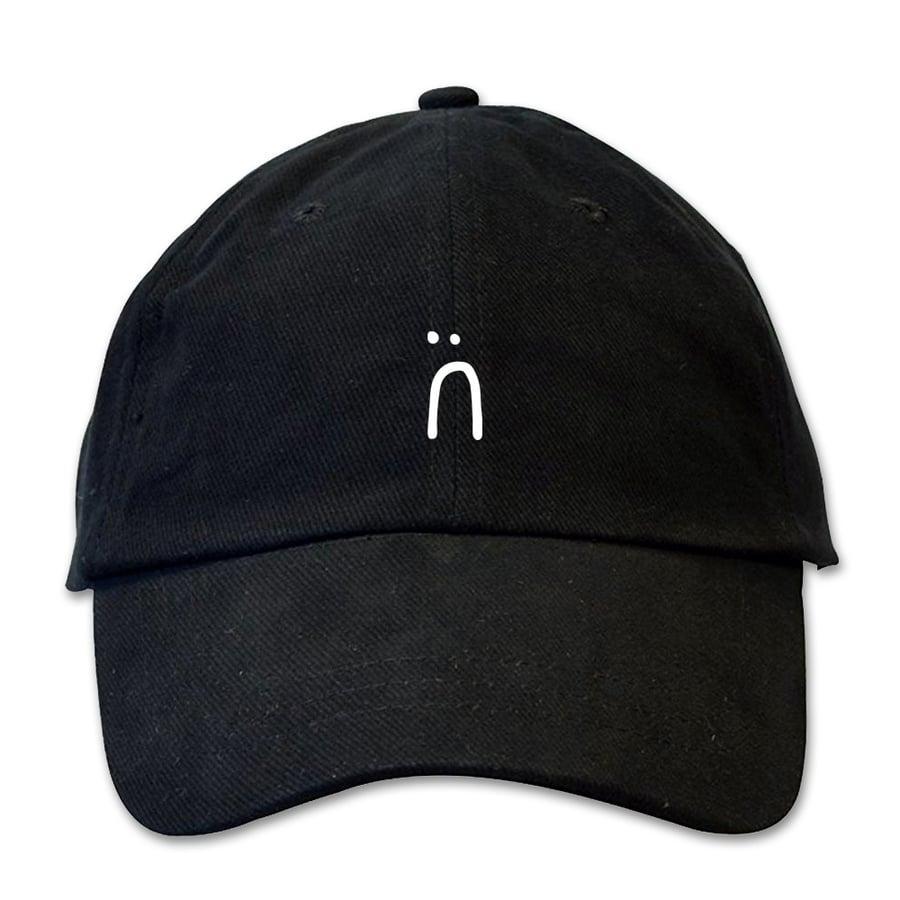 Image of sad face dad hat