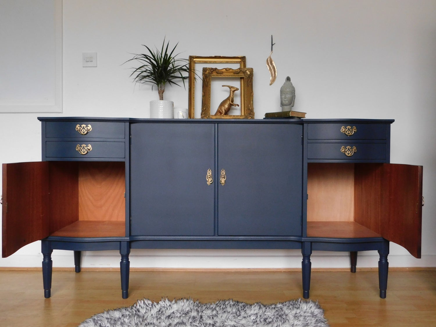 Image of A dark blue wooden sideboard