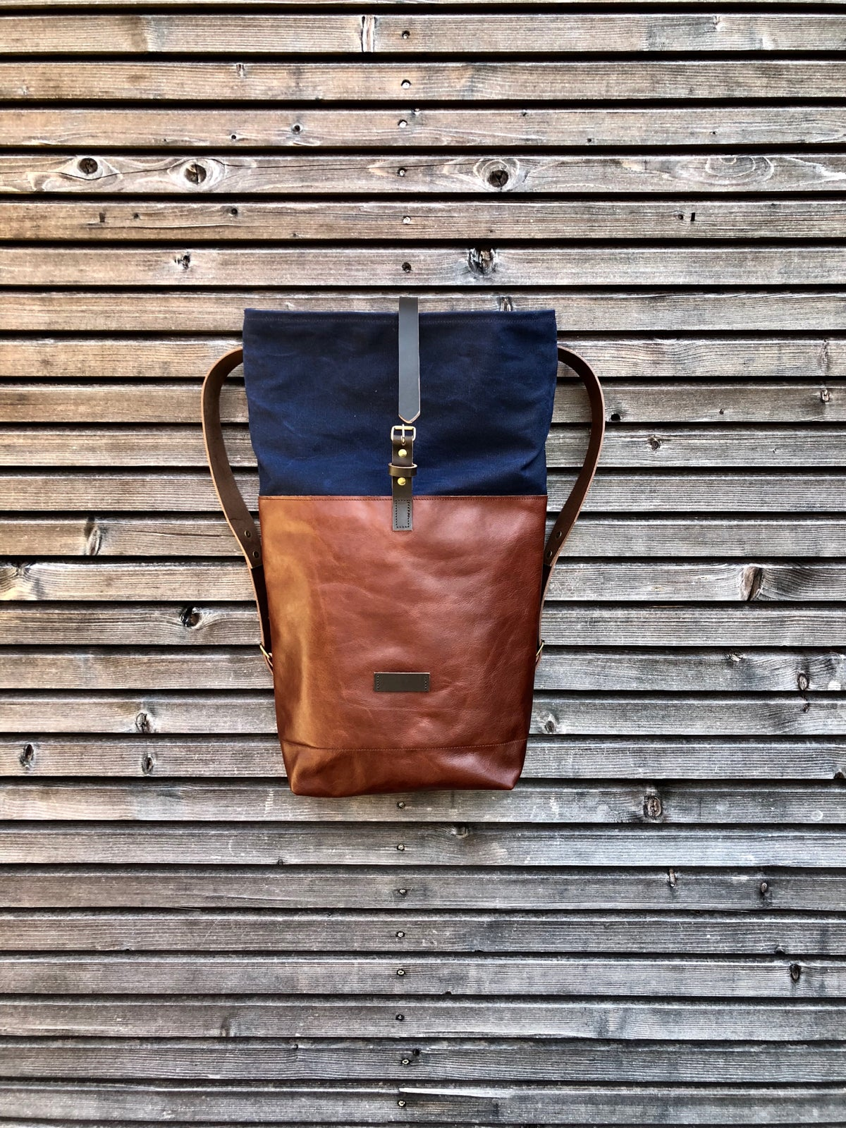 Image of Backpack in oiled leather with waxed canvas roll to close top in waxed canvas