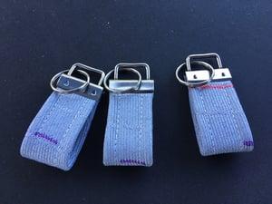 Image of Grey M rain Key Chain