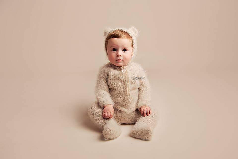 Image of Knitted sitter  footed teddy bear romper. Made to order