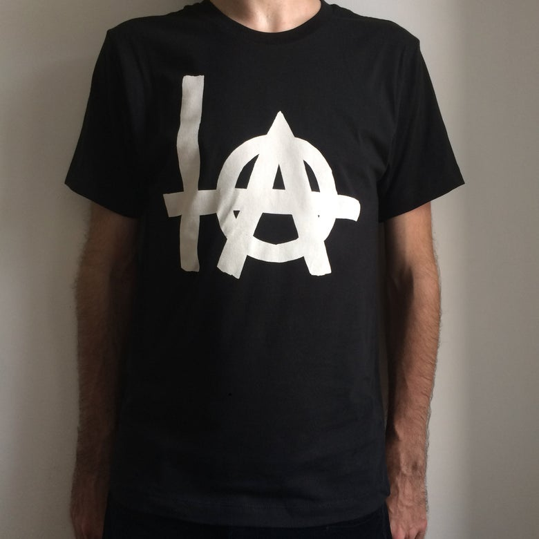 "Image of BLACK ""+@"" LOGO SHIRT"