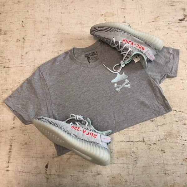 "Image of YEEZY CROSSBONES EMBROIDERY ""BLUE TINT"" T-SHIRT"
