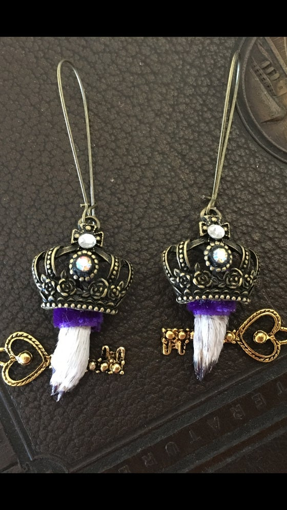 Image of Taxidermy earrings featuring guinea pig paws with crowns holding keys