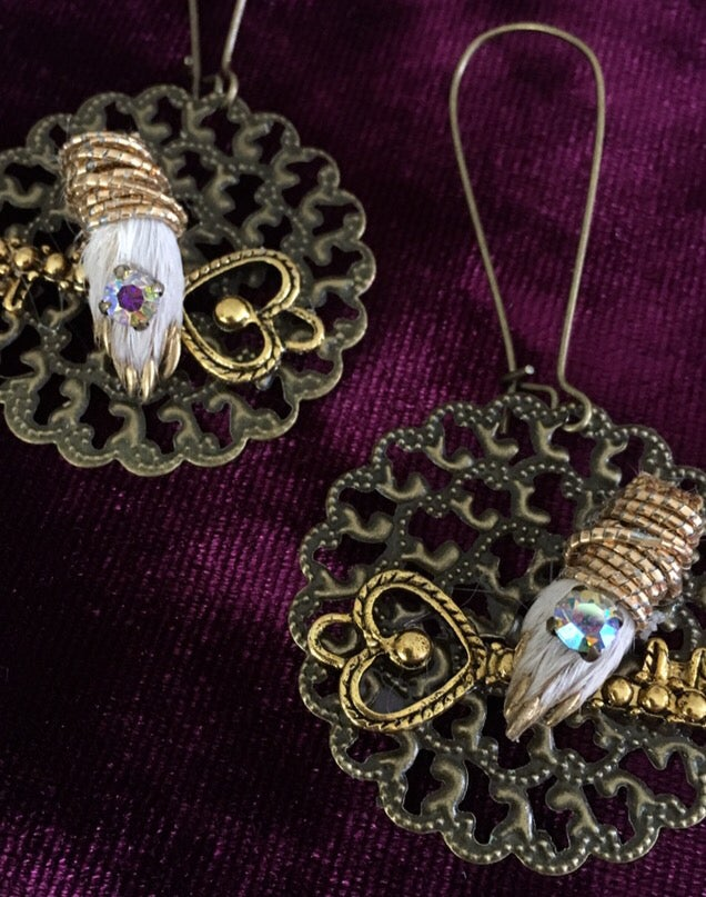 Image of Taxidermy earrings with guinea pig paws clutching keys