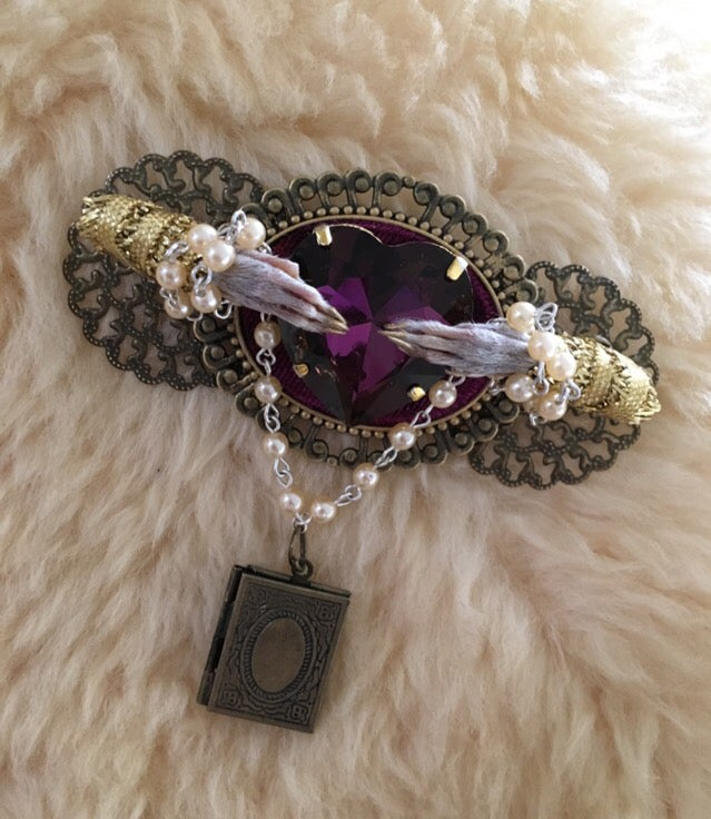 Image of Taxidermy brooch with purple rhinestone and two rat paws