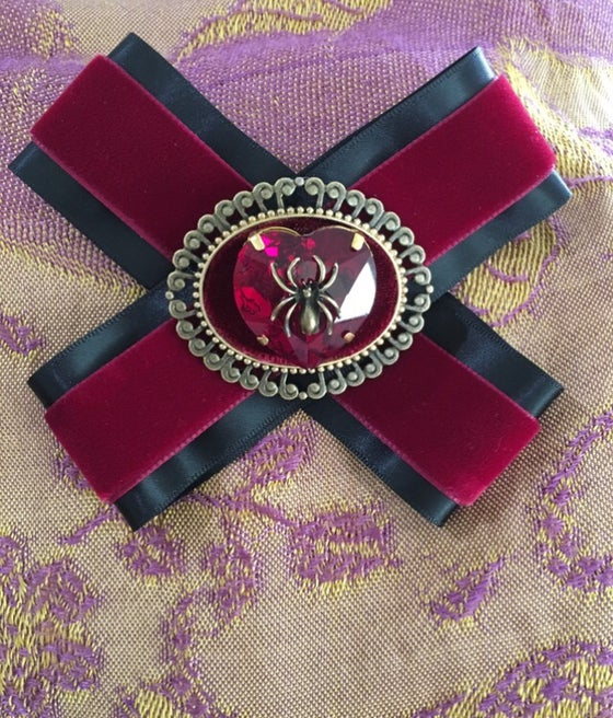 Image of Red rhinestone heart spider brooch