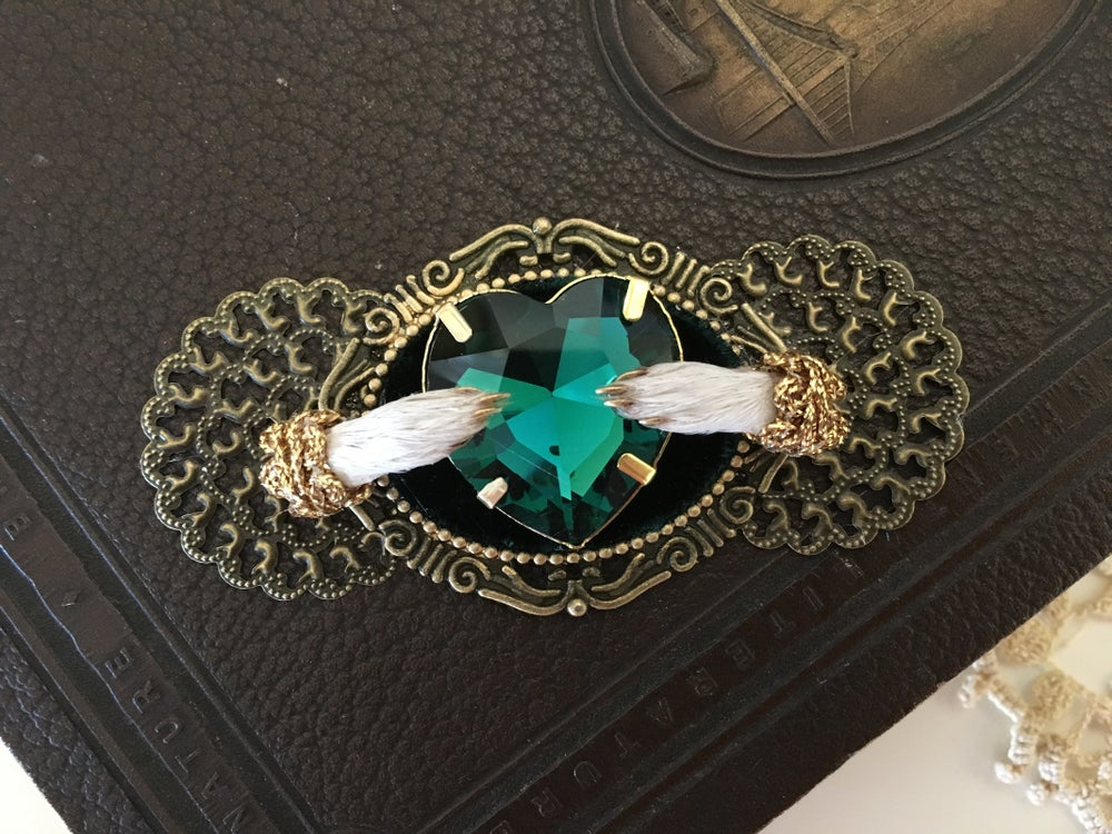 Image of Taxidermy brooch with emerald rhinestone heart and guinea pig paws