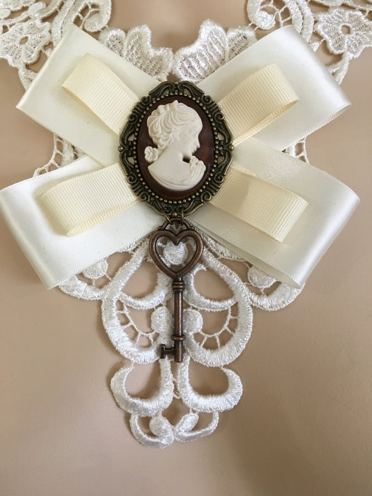 Image of White lace necklace with cameo and key