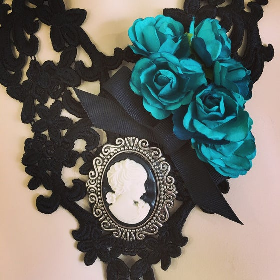 Image of Black lace necklace with blue flowers and black cameo