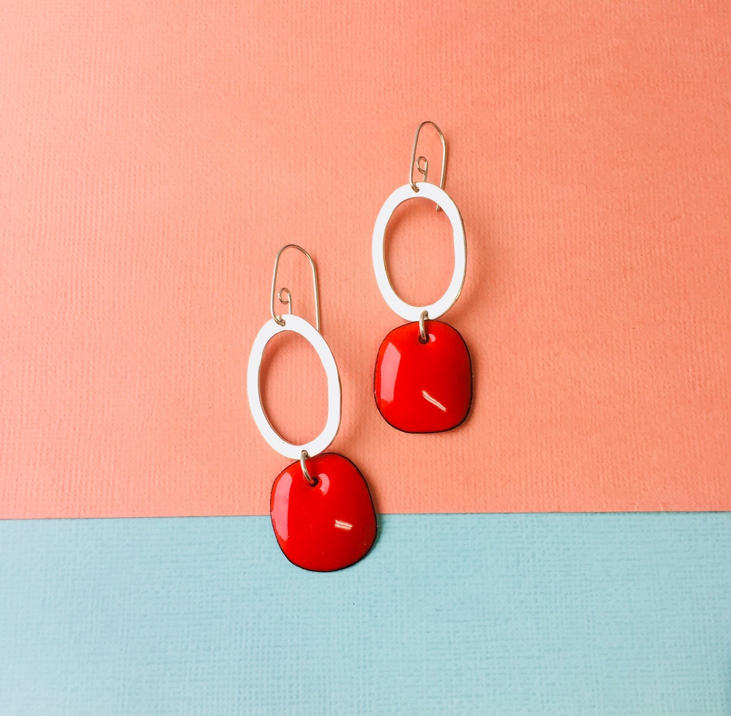 Image of Handmade Sterling silver hoop earring with tangerine red enamel drop