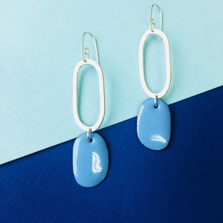 Image of Sterling silver hoop earrings with oval enamel drop