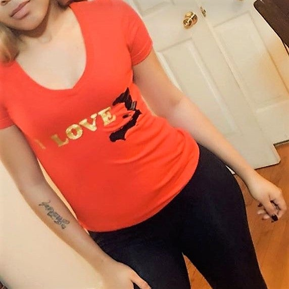 Image of red  black and gold shirt