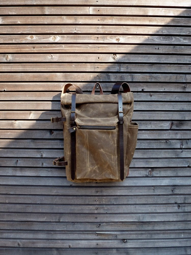 Image of Waxed canvas backpack with roll to close top and vegetable tanned leather shoulderstrap and back rei