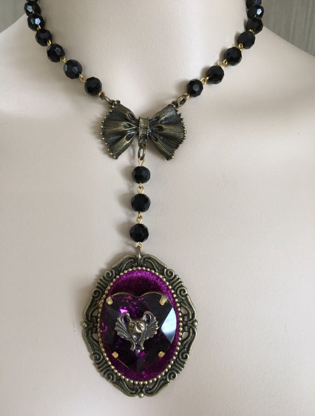 Image of Black collar necklace with purple rhinestone heart and screaming bat face