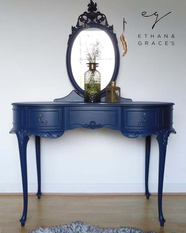 Image of A elegant dark blue dressing table