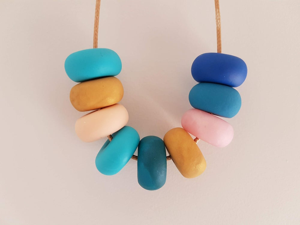 Image of Blue, pink and gold clay bead necklace