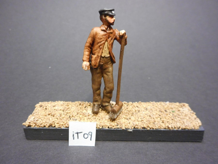 Image of IT 09 Workman standing holding broom