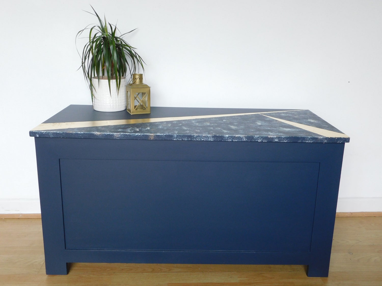 Image of A dark blue & gold design storage box