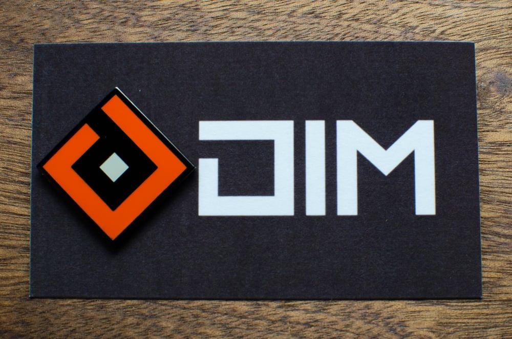 Image of DIM Logo Enamel Pin (Release Orange)