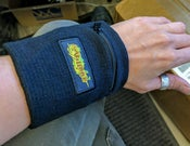 Image of Village logo wrist cuff with zippered pocket