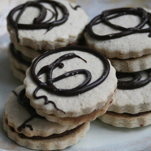Image of GLUTEN FREE-  Shortbread Sandwich Cookies with Chocolate Butter Cream Filling - ONE DOZEN