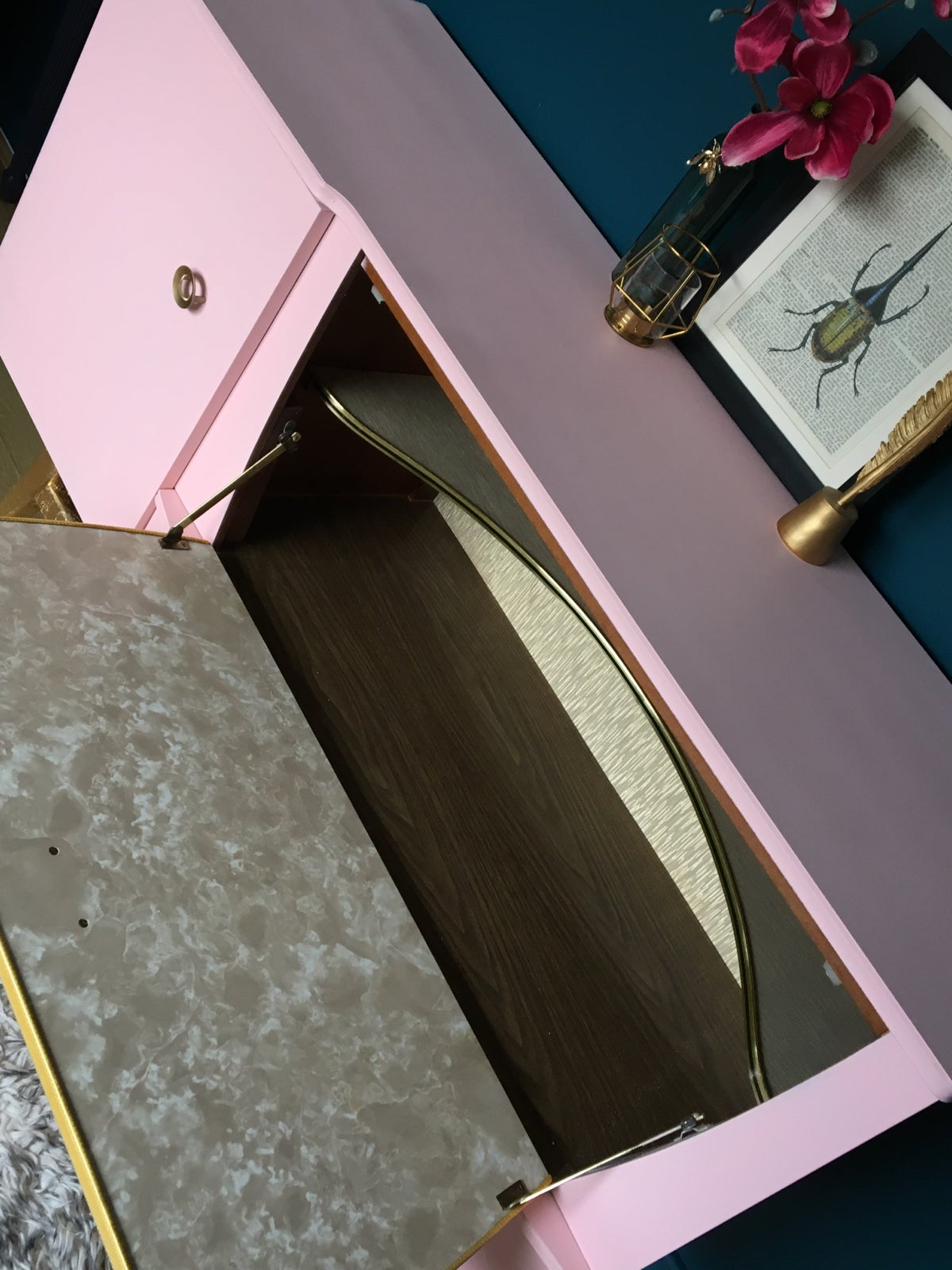 Image of A mid century modern drinks sideboard in pink & gold