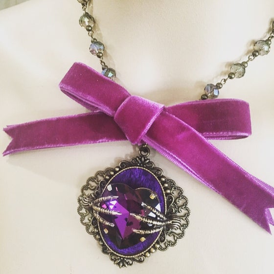 Image of Rosary bead choker with purple ribbon and purple rhinestone hear and raven claws