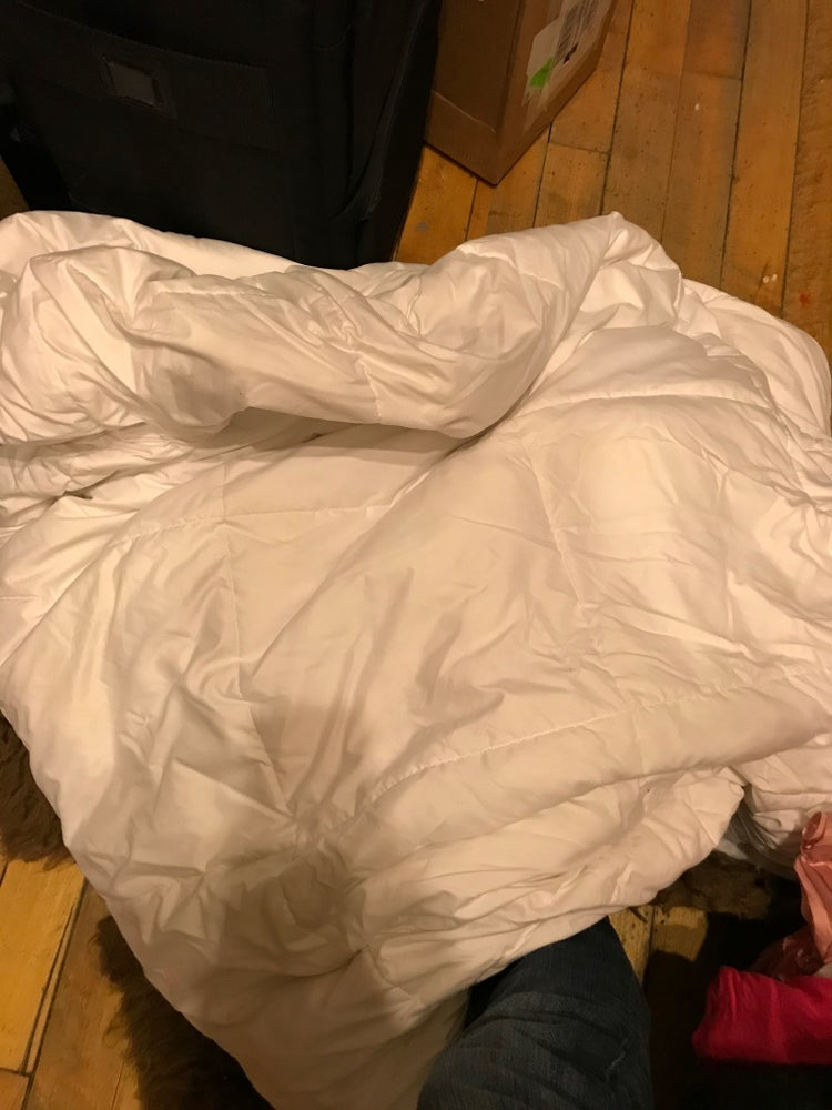 Image of White down comforter